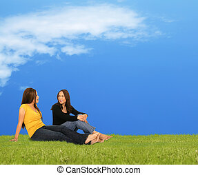 Two Girls Relaxing On Grass