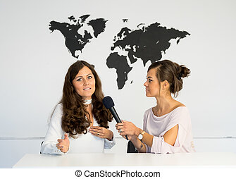 Two girls reporters twins are reporting from a white studio...