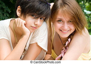 Two girls rest on fresh air outdoors