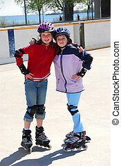 Two girls rollerblading - Two young girls rollerblading