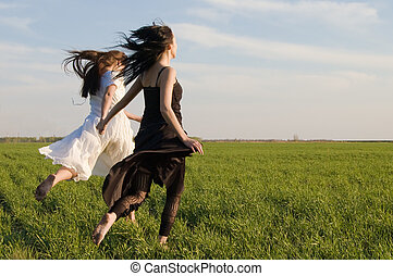 two girls running on the field 3