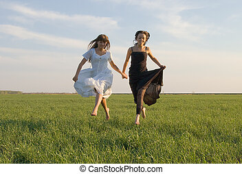 two girls running on the field 4