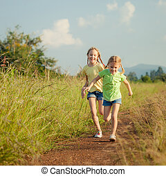 two girls running on the road
