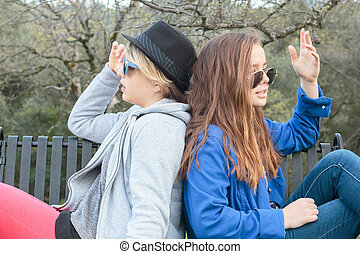 Two Girls Setting on a Bench