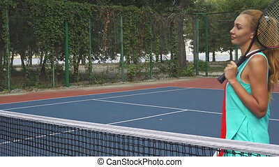 Two girls shaking hands before playing tennis