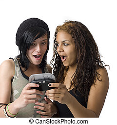 Two girls share cell phone