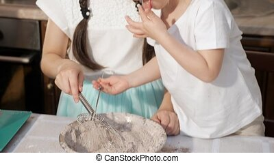 Two girls sisters are mixing ingredients in a bowl. - Girls...