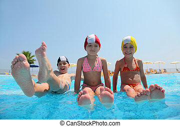 Two girls sit on skirting in  pool and feet overwater and boy lift which falls in water, underwater package shot