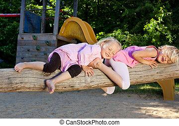Two girls sleeping in the sun