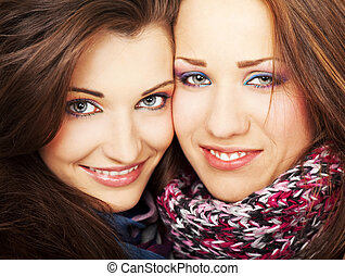 Two girls smiling