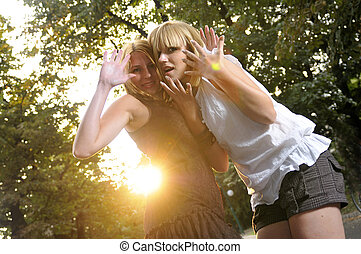 two girls together outside in dancing position ready for...