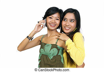 Two girls using cellphone