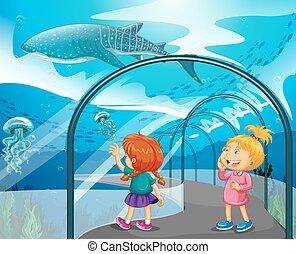 Two girls visiting aquarium