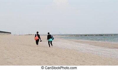 Two Girls Walking on Beach