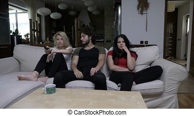 Two girls watch TV with their boy friend and switch the...
