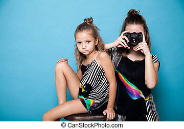 two girls with a camera on a photo shoot