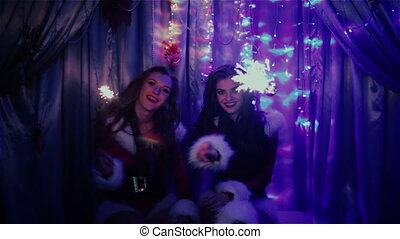 two girls with Christmas lights