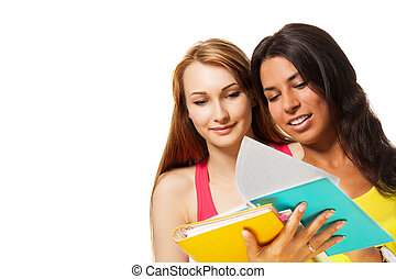 two girls with excersice books
