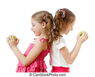two girls with green apple healthy food