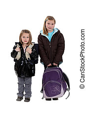 Two girls with schoolbags