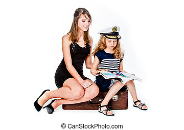 two girls with suitcase