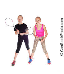 Two girls with tennis racquet.