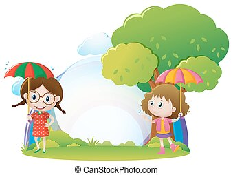 Two girls with umbrella in the park