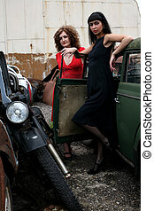 two girls with vintage car