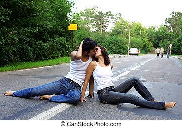 two girs at road