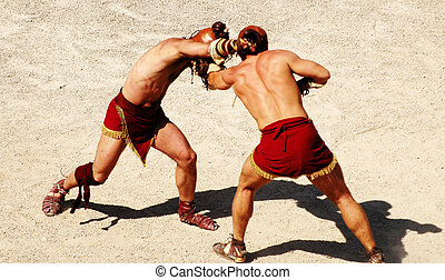 gladiators - two gladiators fighting on the arena of an...