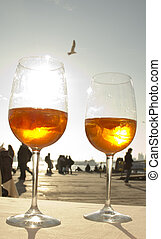 Two glases of Venetian drink and a seagull - Two glasses of...
