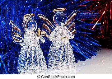 Two glass angel and Christmas tree tinsel
