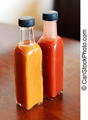 tomato sauce and mustard - two glass bottles of tomato sauce...