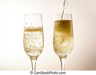 Two glass of champagne wine closeup, bubbles, on a light background