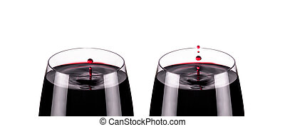 two glass of red wine, drops in motion, studio shot
