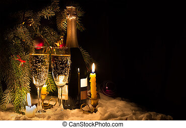Two glasses and a bottle of champagne