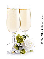 two glasses champagne and bouquet flowers on white background