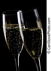 Two glasses champagne on black