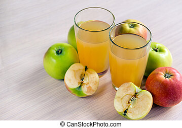 two glasses of apple juice and fresh apples on the table, fruit and fruit juice