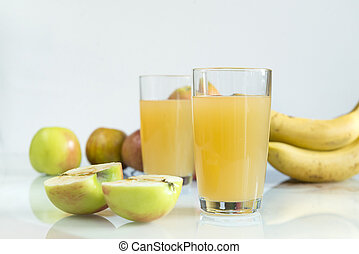 two glasses of apple juice, juice in glasses, fresh apples on a white background