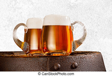 Two glasses of beer on the white background