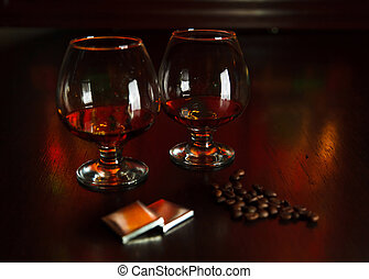 two glasses of brandy with chocolate
