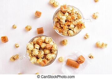 Two glasses of caramel popcorn.