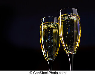 Two Glasses of Champagne against Dark Background