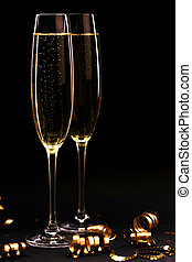 Two glasses of champagne full size on black background.
