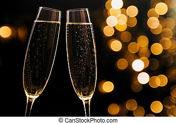 Two glasses of champagne on black stylish background. Place