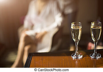 two glasses of champagne on the background the female silhouette