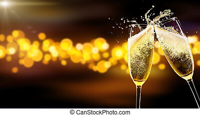 Two glasses of champagne over blur spots background - Two...