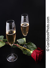 two glasses of champagne with rose