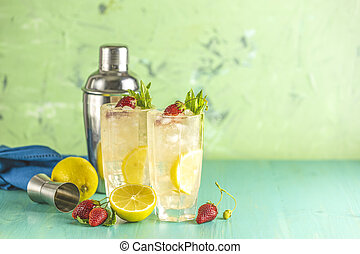 Two glasses of cold icy refreshing drink with lemon and ...